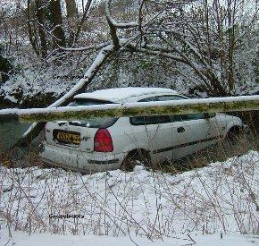 car crashes into stream