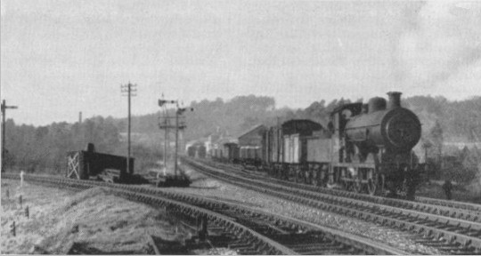Locomotive 32551 shunting on the Petersfield line at Midhurst. The Chichester line is to the left. photo C. Hogg C1954