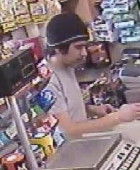 Till Thief caught on camera Unusual food Store, North Street - click